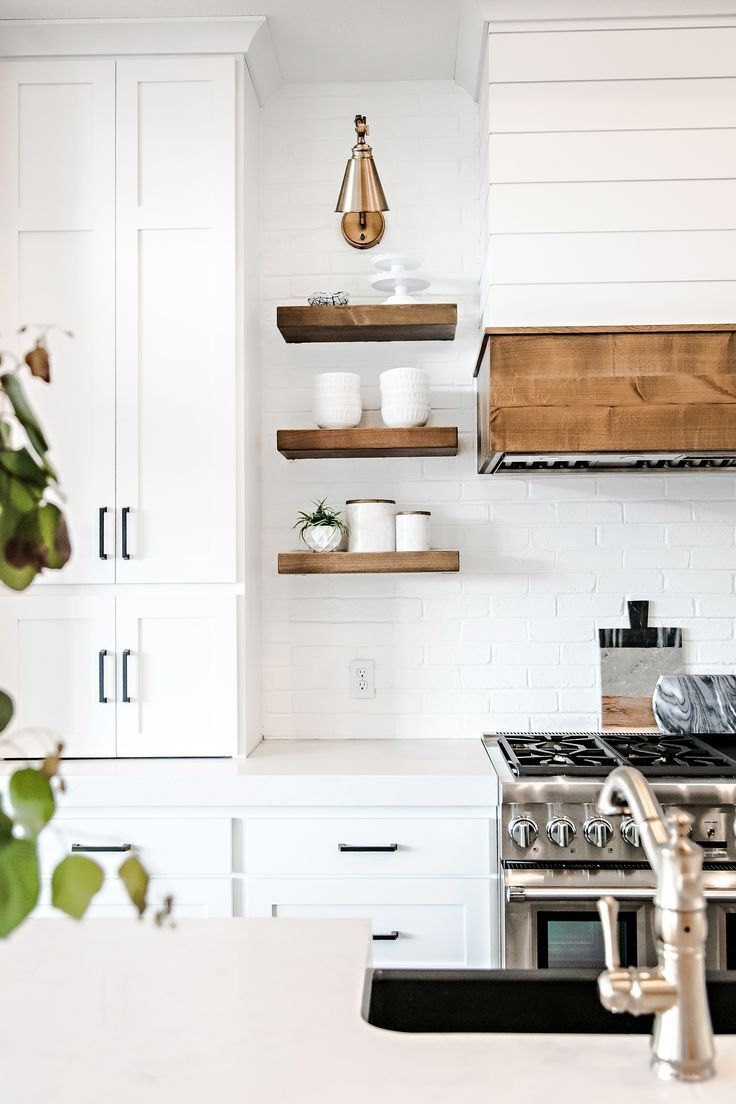White Cabinets With Quartz Countertop And Wood Accents Trendy