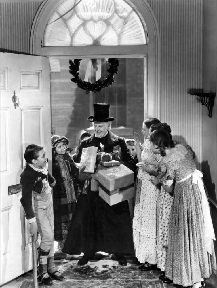 reginald owen as ebenezer scrooge and terry kilburn as tiny tim in a christmas carol 1938