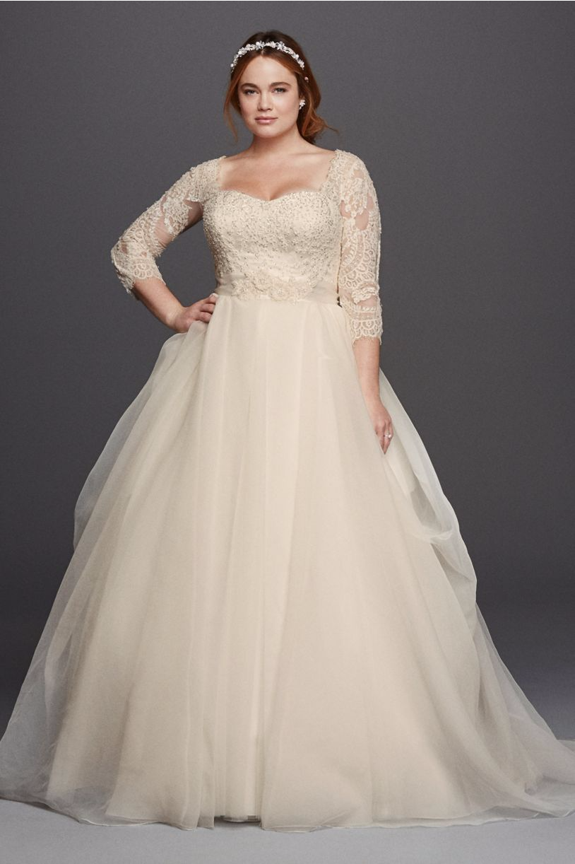 Girl with curves featuring plus size organza and lace ballgown from
