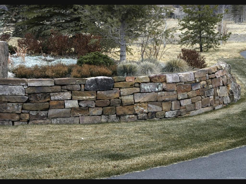 Flat stack rock retaining wall stacked stone retaining for Rock wall garden
