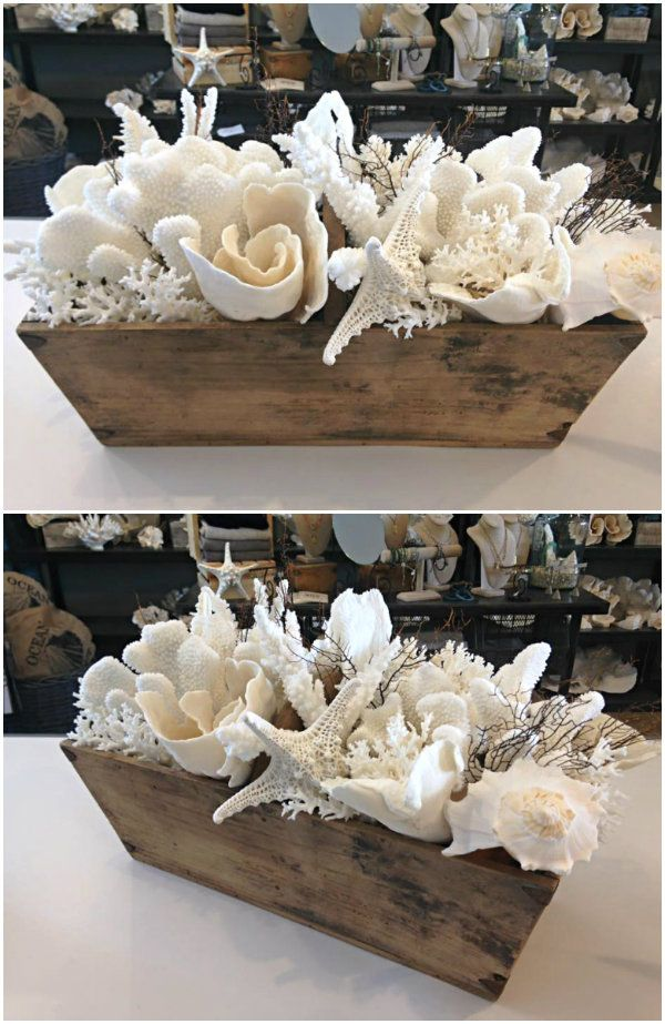 These rustic wooden troughs full of seashells are the