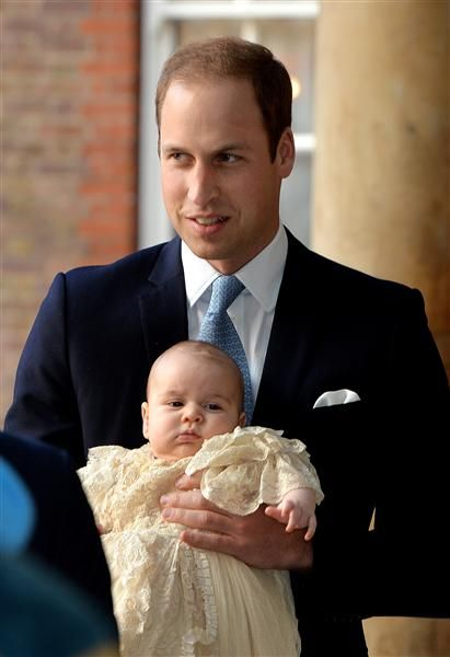 Prince William holds his son, Prince George, at the chapel in St James' Palace, before his christening.