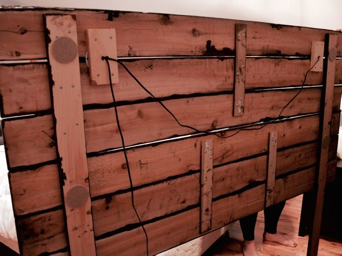 Back of the headboard showing the legs, strapping and wiring