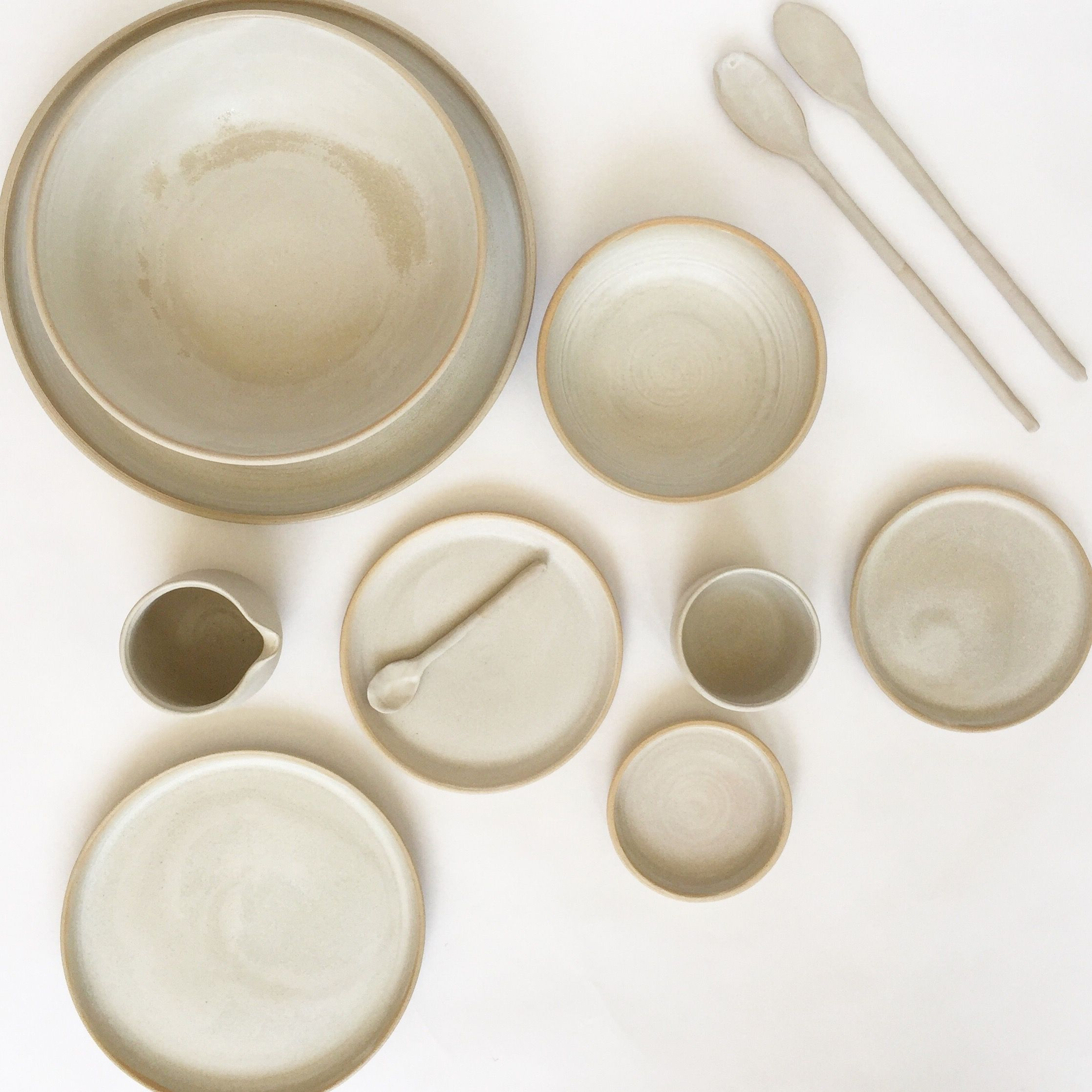 Offwhite Ceramic Dish Set With Bowls Plates And Spoons This Minimal Collection Of Stoneware Dishes Looks St Ceramic Dish Set Stoneware Dishes Ceramic Dishes