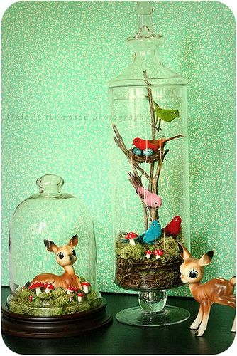 <3 Put vintage figurines in glass display jars with landscapes..protects and looks cute