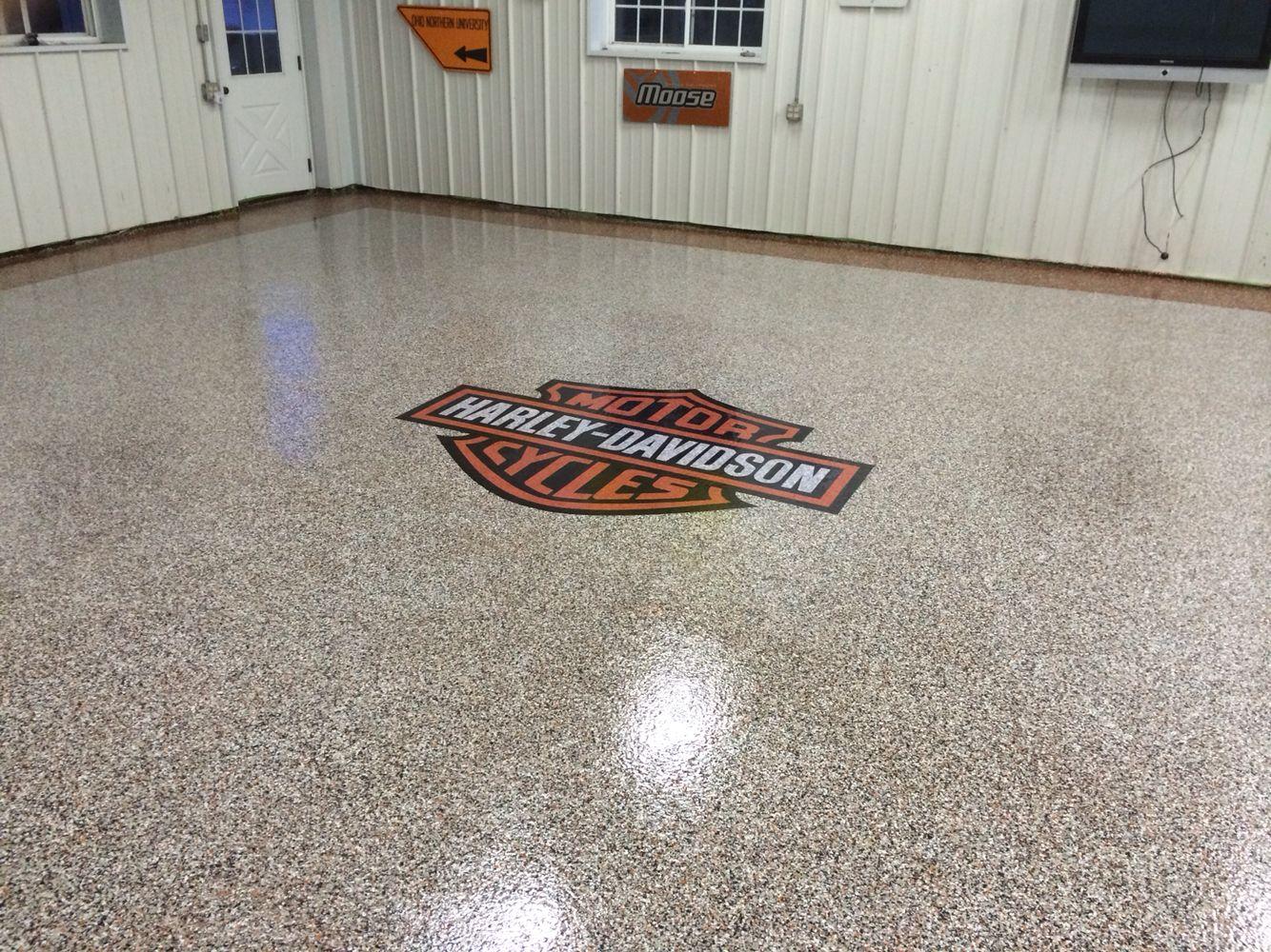Epoxy chip garage floor Harley Davidson logo installed by Re