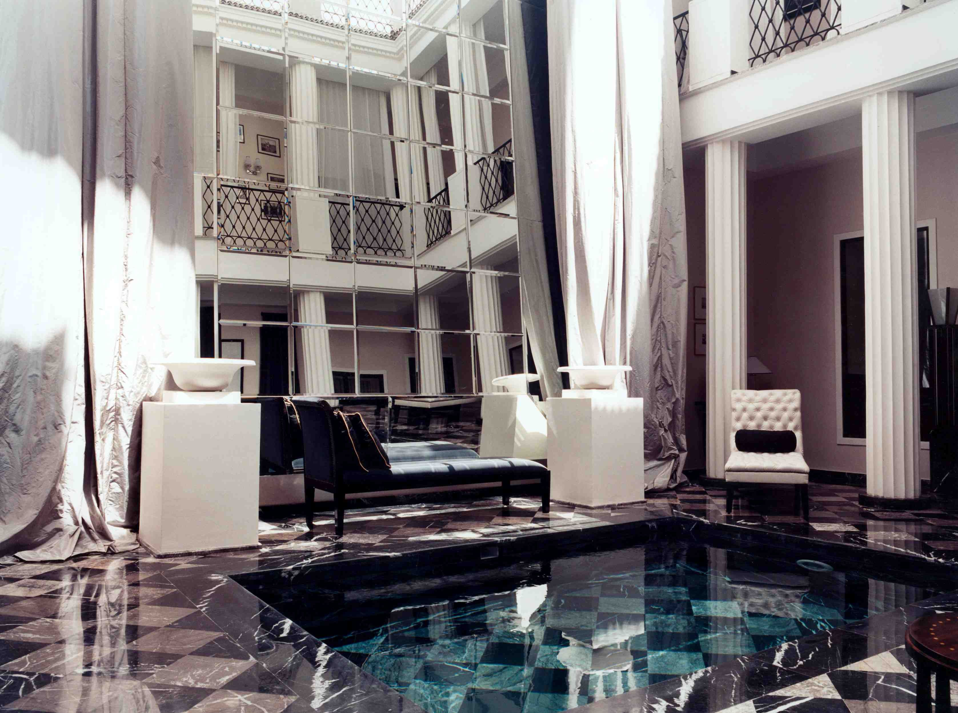One of my favorite modern Moroccan riads! Beautiful pool with a huge mirror installed in the open courtyard.  #Moroccan #Chic #Decor.