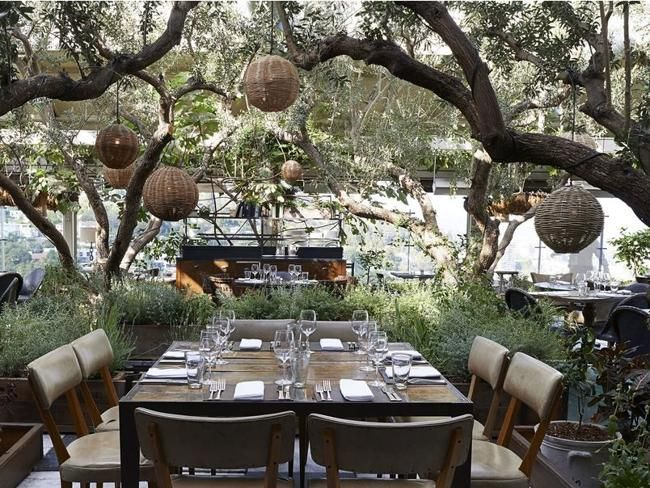 Rooftop Dining Area At Soho House West Hollywood. Lush Gardens.