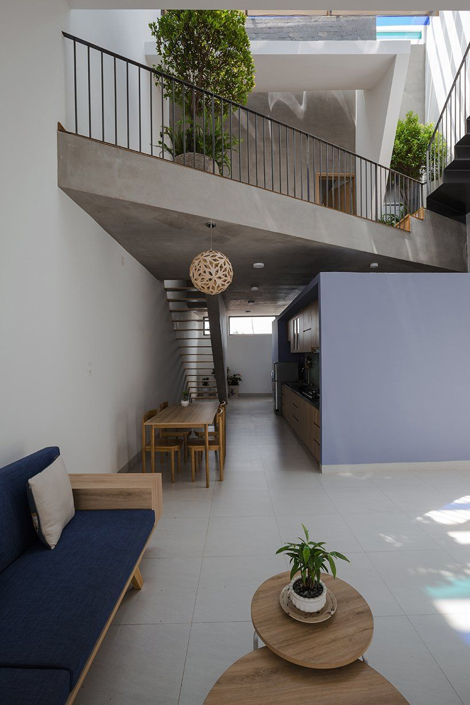 23o5 studio's tinted veranda playfully colorizes the 'loc house' in vietnam