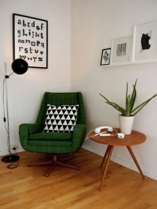 Making a plain white room pop with green. We are in love.