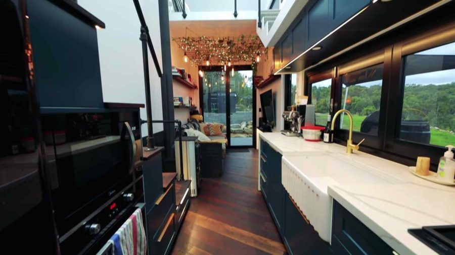 Couple's Mind-blowing Tiny Home w/ Dual Shower Bathroom, Custom Outdoor Catwalk, And More… #tinyhousebathroom