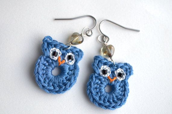 Crochet owl earrings made from embroidery thread, little black seed beads for eyes and with a little grey heart shaped glass bead. They are very lightweight and easy to wear. The owls measure 0.9 / 2.3cm.   Ear hooks are surgical steel.    Shipping:  I will send your package within 3 business days after order and payment is complete.  Shipping is by Canada Post.    I try to take accurate pictures of my items, please keep in mind that colors may vary monitor to monitor.
