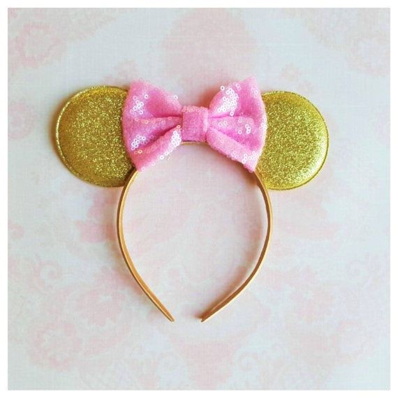 ~~ Pink and gold Minnie mouse ears headband ~~  These Adorable Minnie Mouse Ears would be the perfect addition to any of our birthday outfits, Disney Vacation, or every day wear.  They are in gold glitter color embellished with pink sequin bow.   Please note: Top quality materials are used to make all our designs.   Design will be exactly as pictured.  Please feel free to contact me with any question you may have.  Thanks for visiting my shop.
