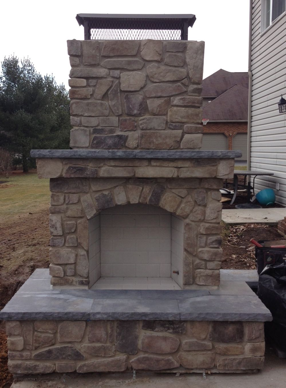 Outdoor fireplace with stone veneer Still working on the rest of