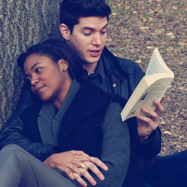holding hands like that probably makes it really hard to turn the pages,but being read to! ...awsome