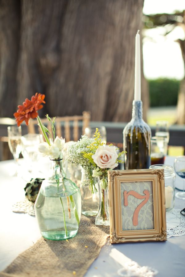 burlap table runner and mismatched glass vases