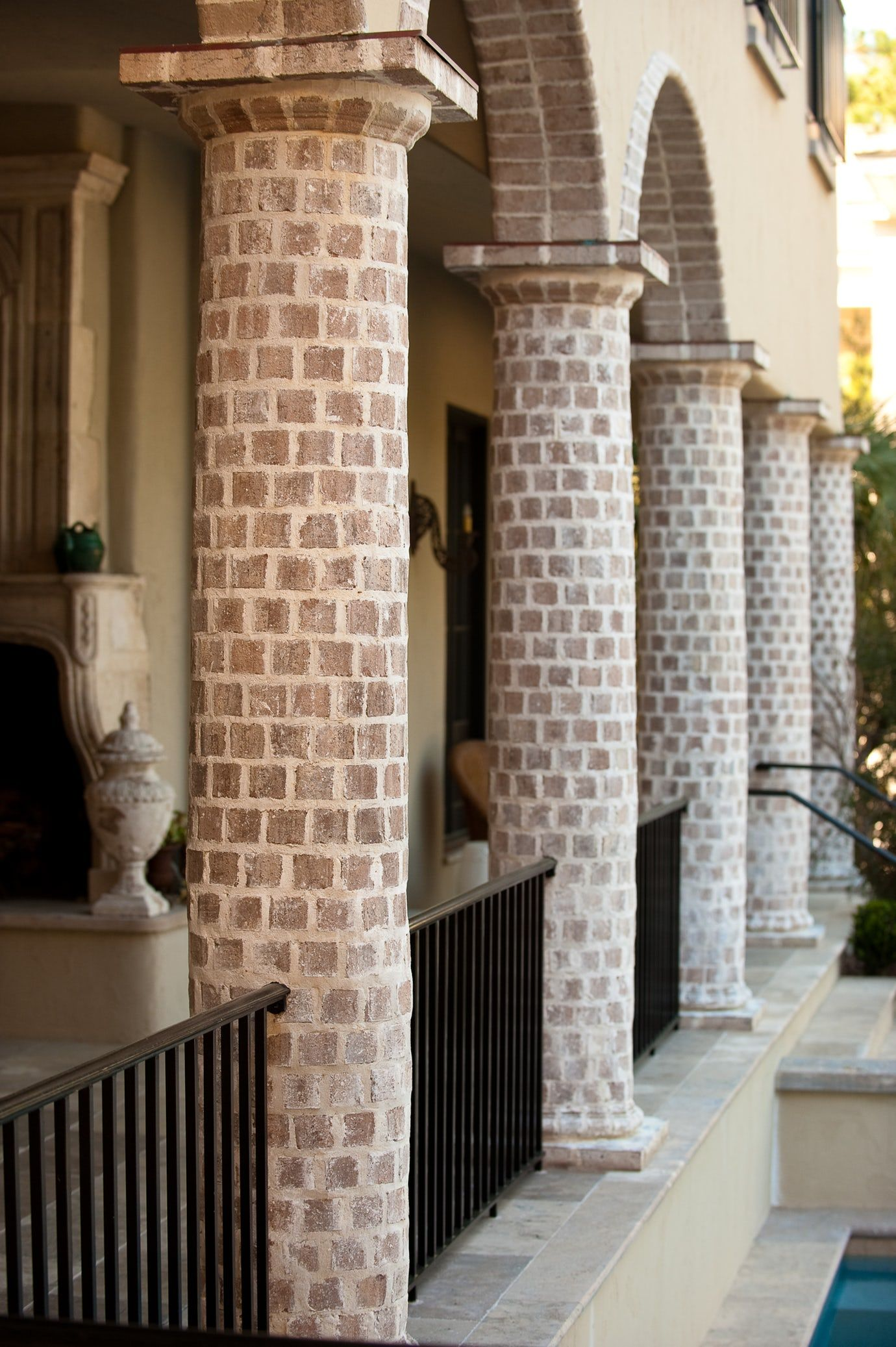 Round Brick Column Loggia With Brick Arches And Black