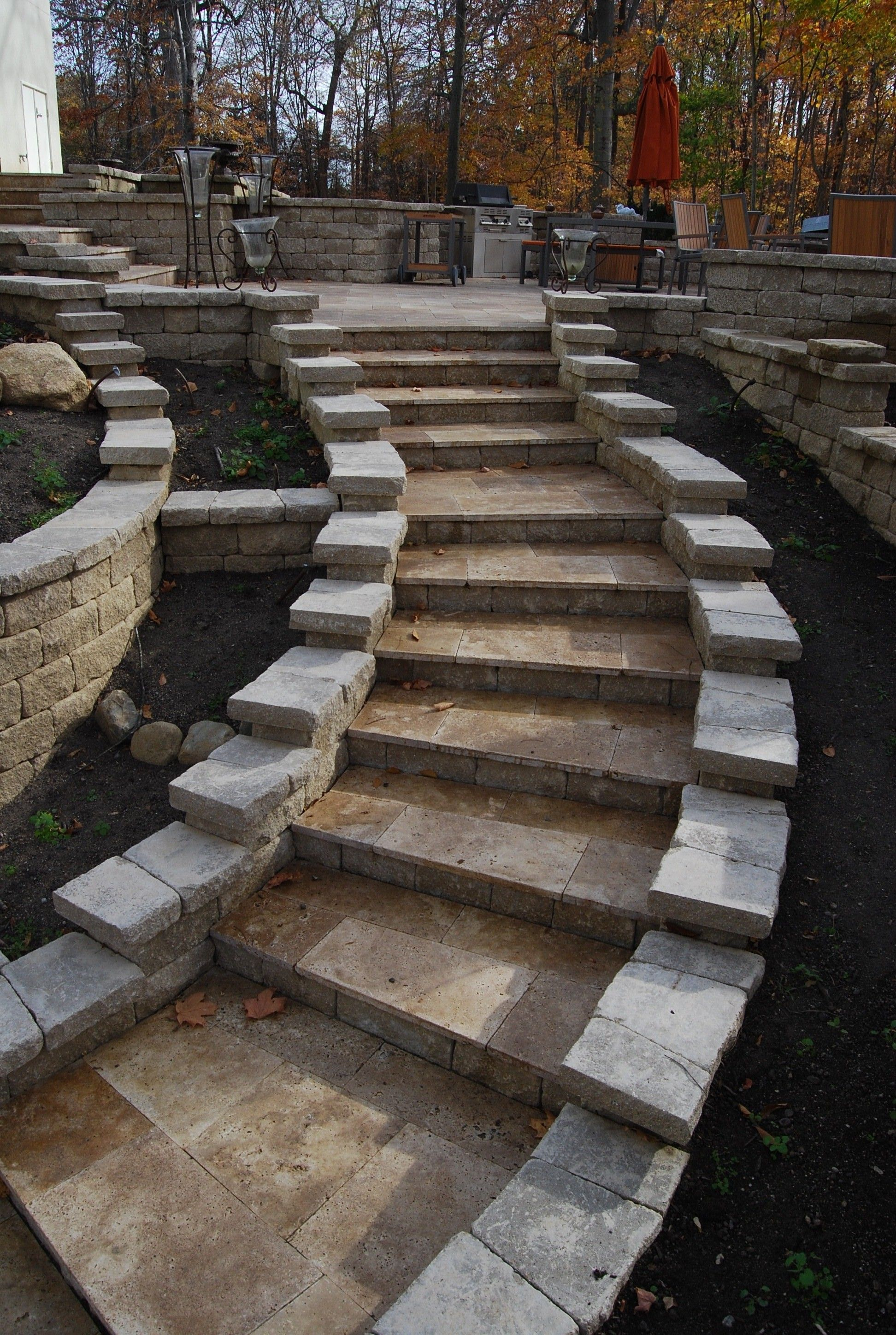 Travertine steps hardscape pavers design fall patios Travertine designs