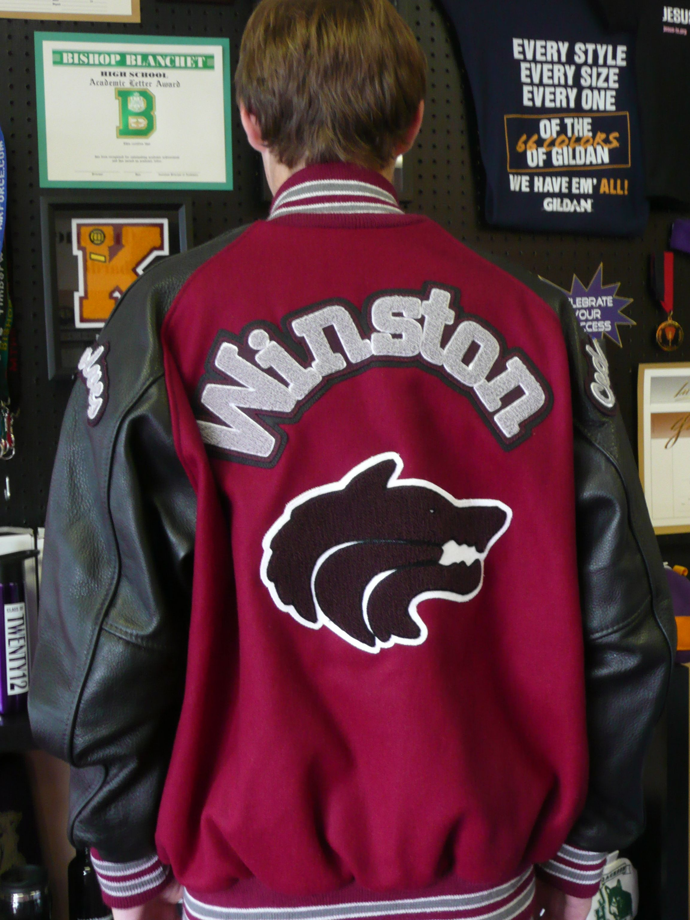 boys red and black letterman jacket with wolf