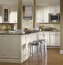 Off White Kitchen Makeover Adds Aristokraft Cabinets, Granite Counters And  Kitchen Island