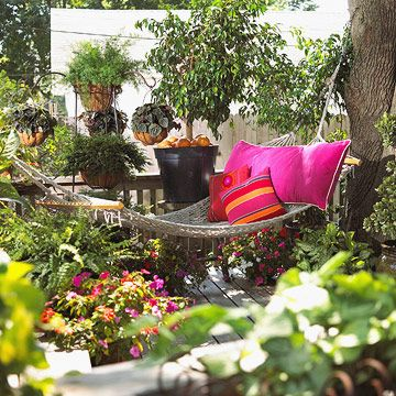 """""""Hello, Hammock! The hammock has been around more than 2,000 years, and there's a reason it has such staying power. Paired with a lush container garden, this one turns an unassuming deck into an exotic backyard oasis.  Learn how to choose the perfect hammock."""" • by Jessica Abels http://www.bhg.com/home-improvement/porch/outdoor-rooms/easy-outdoor-room-ideas/#"""