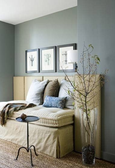 Built in sections of headboard in a recessed corner create a sofa
