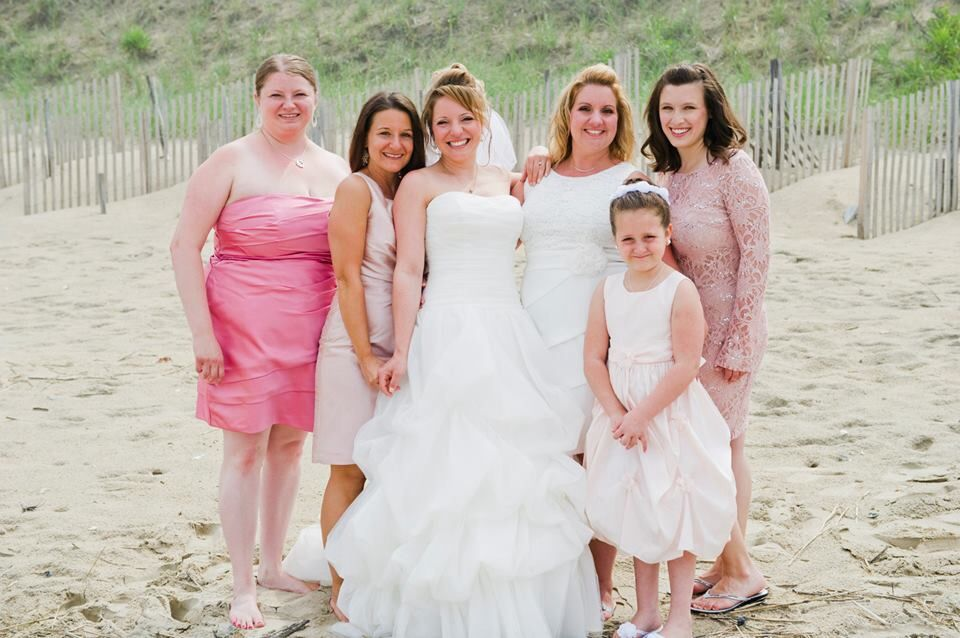 OBX beach wedding. Bridesmaids wear different dresses in various ...