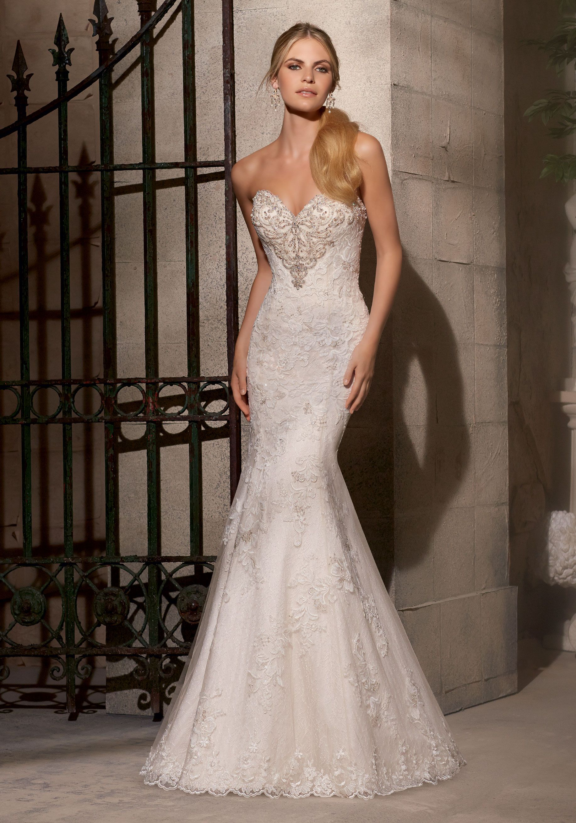 Layers of lace create a delicate romantic bridal dress with