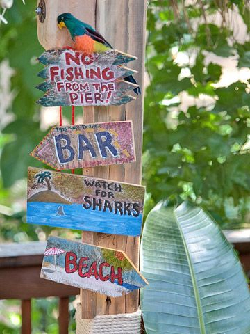 Make a Statement: A collection of cheery signs helps set the tone and adds a playful dose of color. The Langes grow a lot of plants for foliage rather than flowers. Test Garden Tip: Pay attention to plants when planning your backyard. Big, bold tropicals create one look; select lavender, sage, and other silvery-leaf plants for a Mediterranean feel.