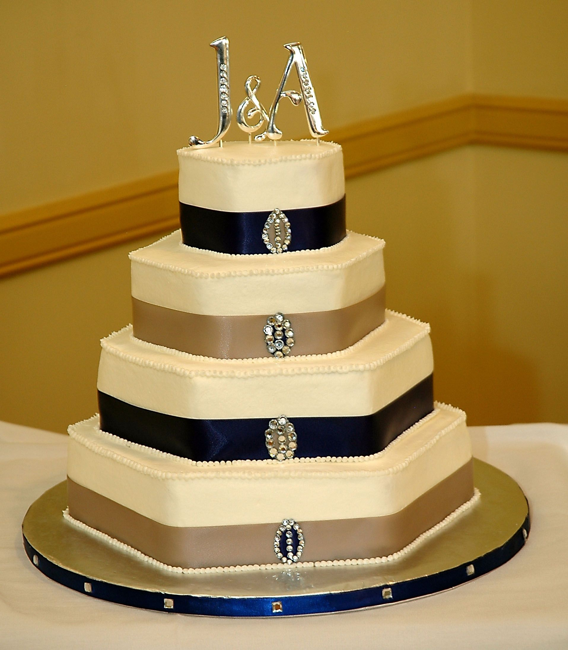 Four tier hexagon buttercream wedding cake with ribbon and bling ...