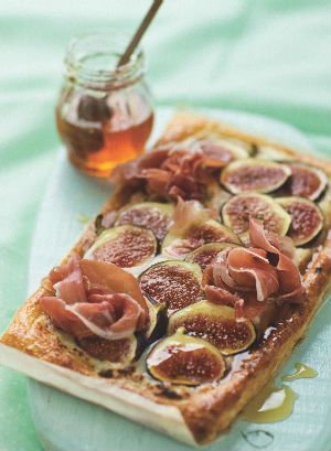 Puff pastry tart with figs, gorgonzola and Parma ham.  Drizzle with honey and serve