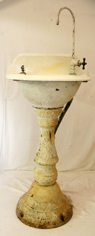 Delightful Early Victorian Cast Iron Pedestal Sink With Faucet And Ornate Carvings.