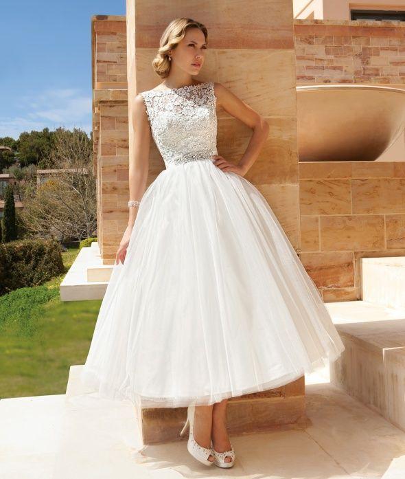Sleeveless Cocktail length destination wedding dress featuring a
