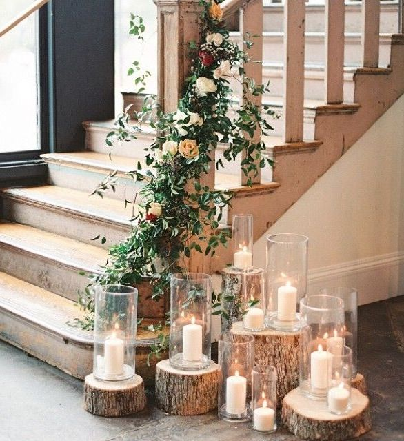 I love the different sizes of the glass candle holders and the tree stumps to give varying heights