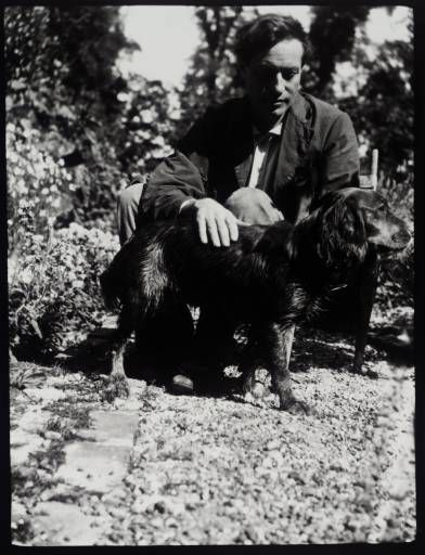 The painter of Bloomsbury group Duncan Grant at Charleston with his pet dog Clinker in 1928.