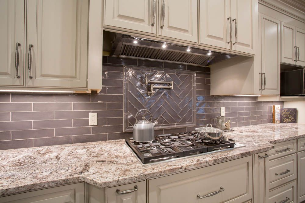 White Torroncino Granite Countertop With Subway Tile Backsplash