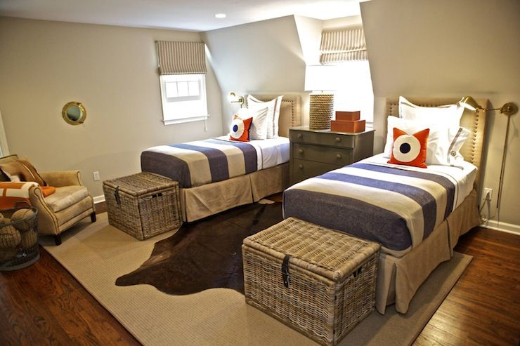 Sam Allen Interiors - twin beds - cowhide layered rug over sisal rug- wicker hampers
