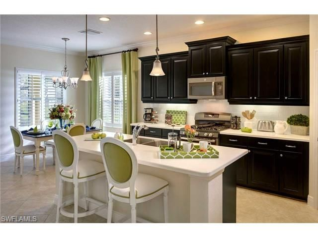 Gorgeous dark and light kitchen with lime green accents.  New executive home in Canopy   North Naples, Florida