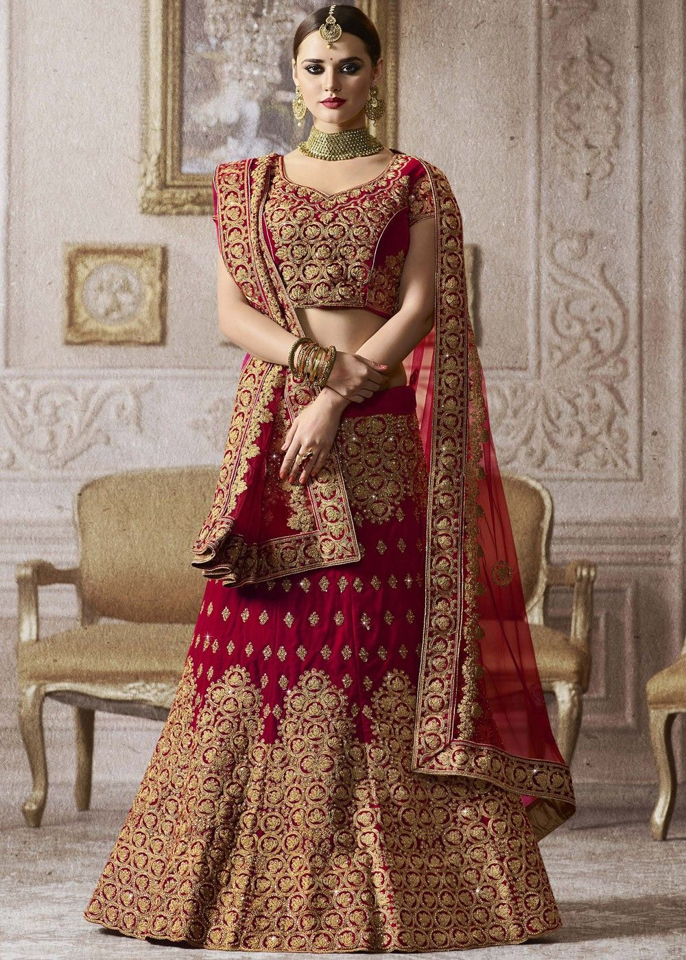 8197d4705b Be the prettiest #bride in this #red #bridal #velvet #lehenga embellished  with all over heavy #zari #embroidery and #kundan work.