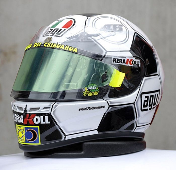 Valentino Rossi football helmet (Catalunya 2008): Valentino sported a tribute to the Italian football team in the Gran Premi Cinzano de Catalunya MotoGP in 2008. The Italians were competing in the European Championships and Valentino's bike was given a paint job to make it look like a football kit, his helmet had a football design, and the famous 46 number was given a makeover to match the numbers that the Italian football team wore.