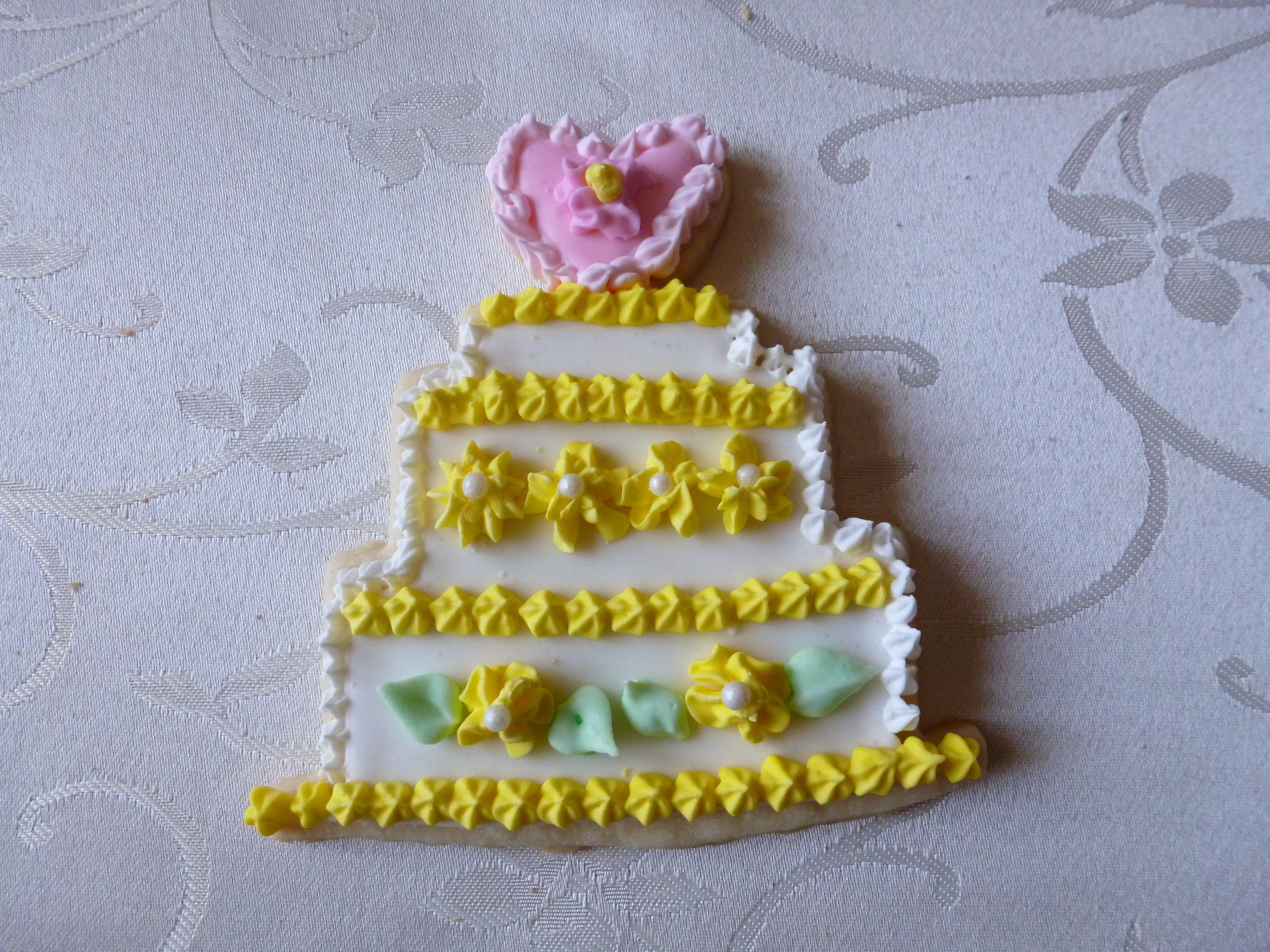 Wedding cake shaped hand-decorated sugar cookie in yellow | 4"|4320|3240|?|en|2|99a9c7207a1ee1714b53ad9416b4e38e|False|UNLIKELY|0.3848755955696106