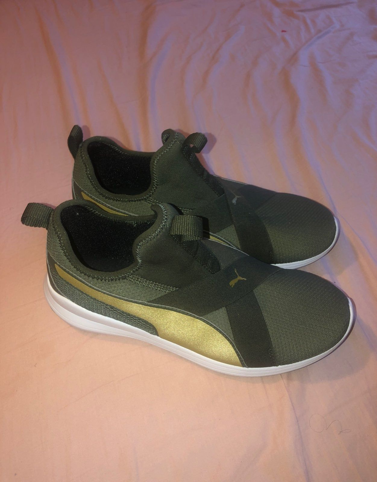 These sneakers are olive green and gold