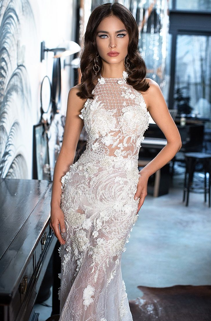 Sleeveless halter neck embroidered with whimsical floral Gorgeous mermaid dress with the removable layered royal train #wedding #weddingdress #weddinggown