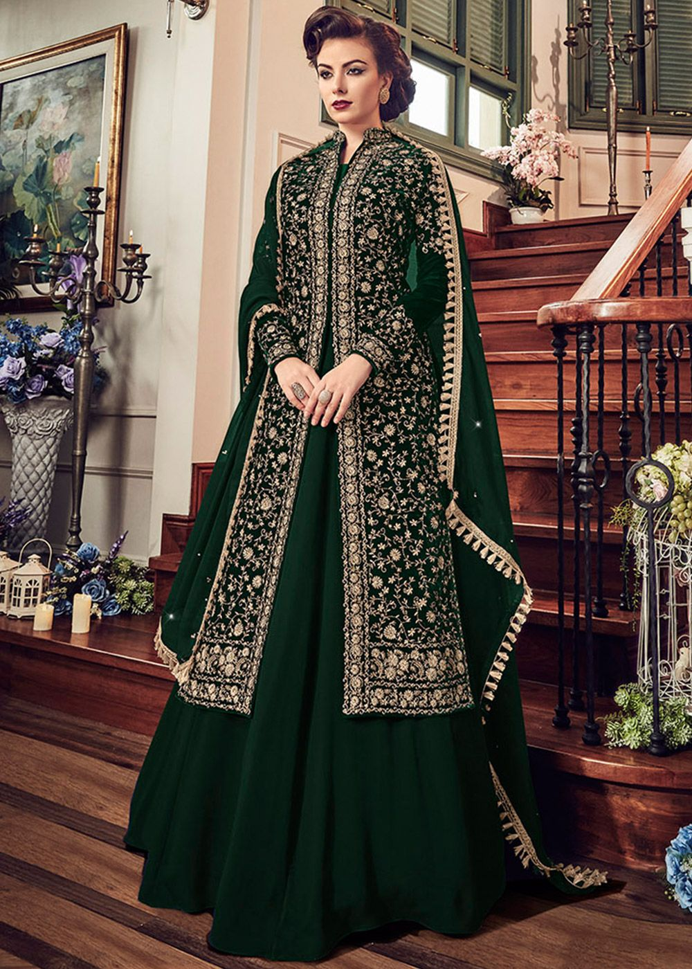6b8db64f7b Featuring a resplendent mandarin neck green velvet embroidered front slit  kameez decked with floral zari embroidery and stone work.