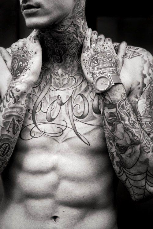 Tattooed guy pleases himself