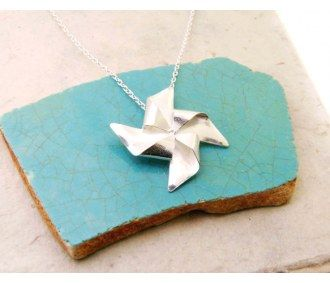 Handmade necklace featuring a rad pinwheel. It may not spin with the wind, but it's certainly beautiful.