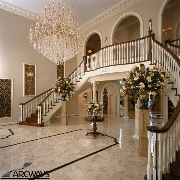 A Grand Foyer With Symmetrical Twin Freestanding Curved Staircases ...magical!