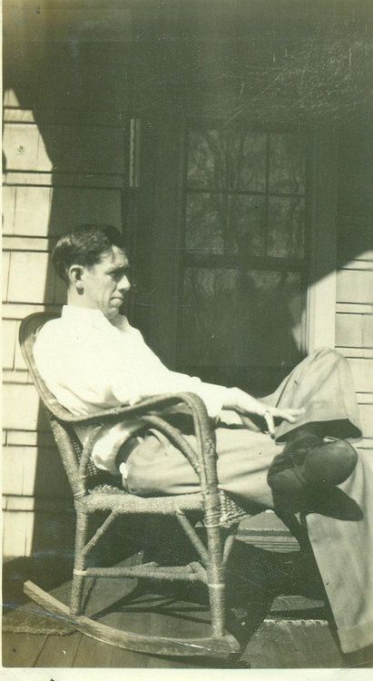 Man Sitting On Rocking Chair Front Porch American Life
