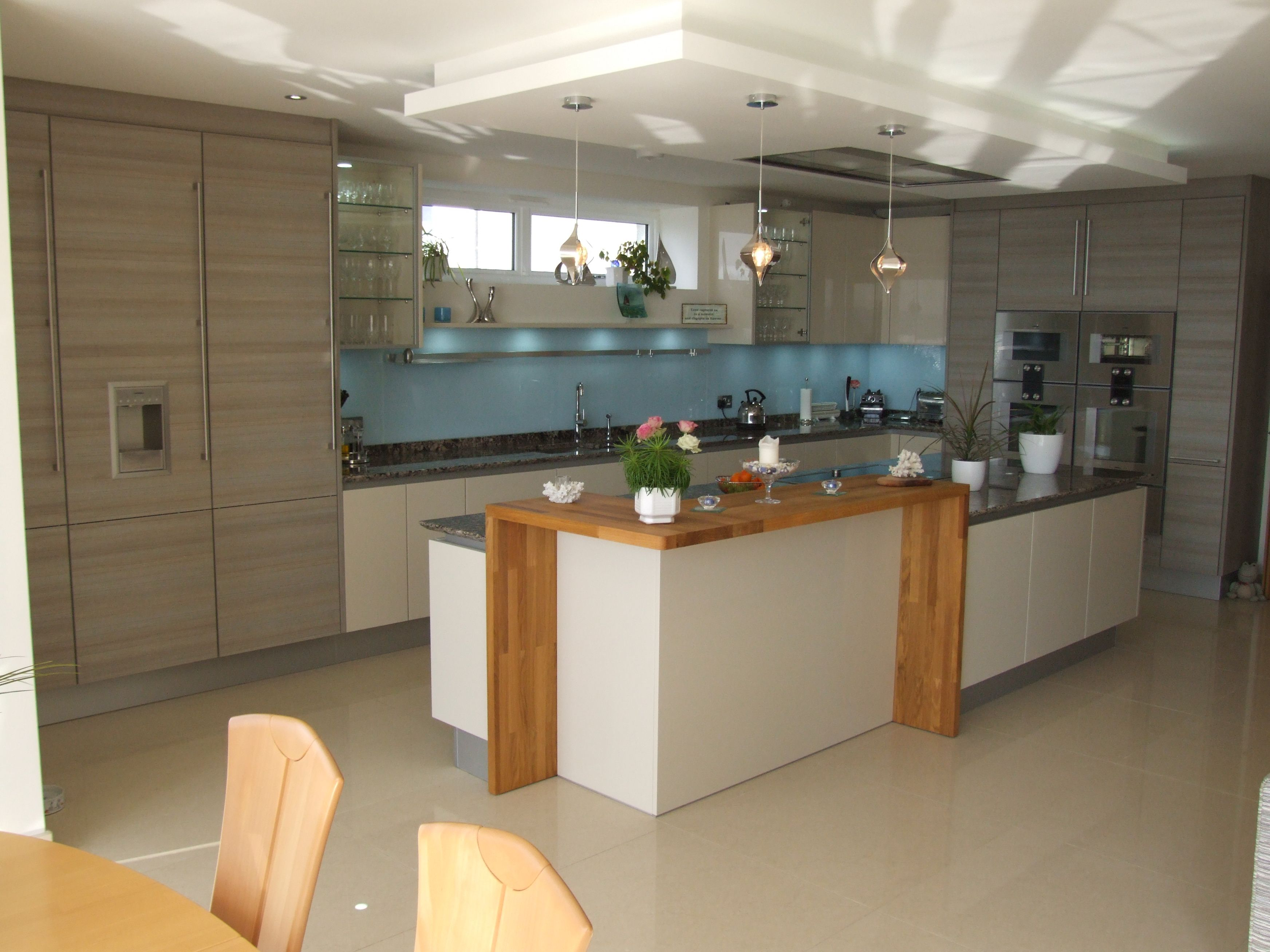 Take A Look At Our Latest Poggenpohl Installation. With High Gloss Sand  Cabinetry, Teak Quartz Tall Units And A Contrasting Spekva Breakfast Bar.