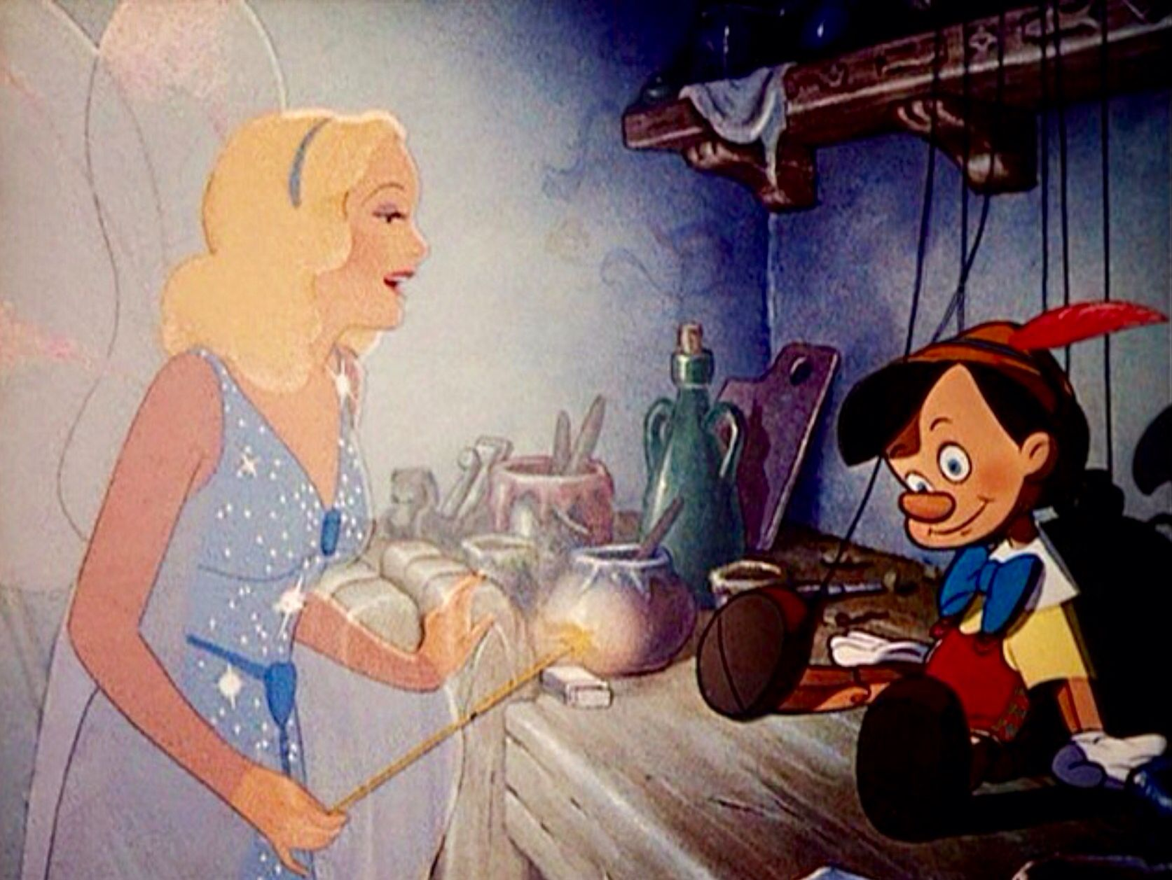 El Hada se acerca al muñeco